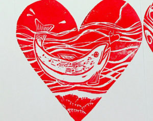A red, heart shaped image of a white fish jumping for a hook baited with a heart.