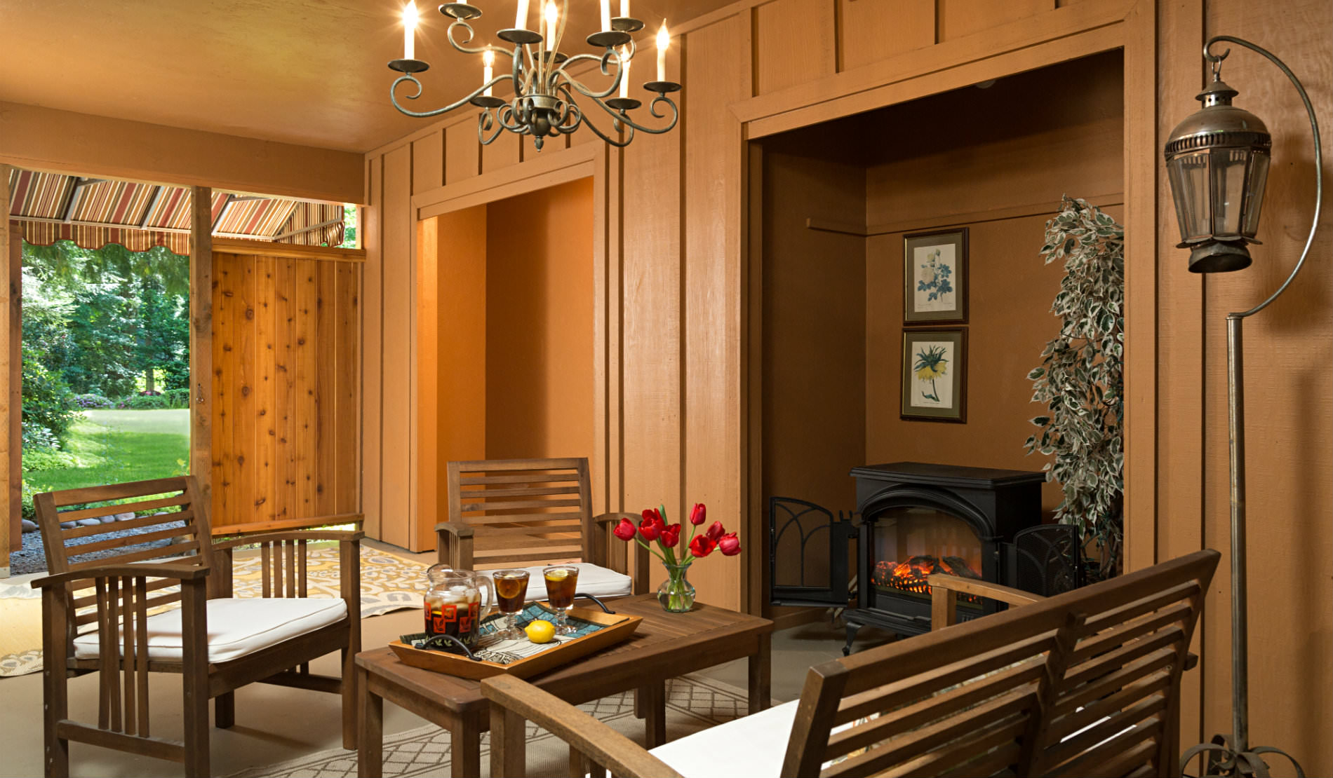 Wood Paneled room with wooden chairs and table set with cold drinks.